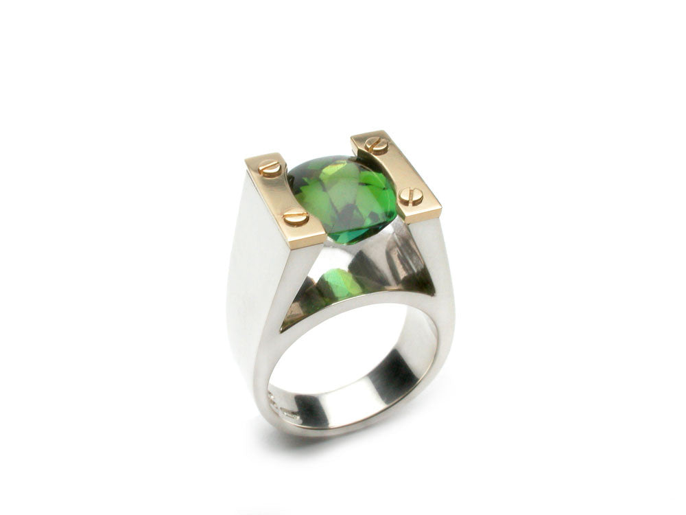 Green Tourmaline 3.72ct., sterling silver and eighteen karat gold. $2,400.00