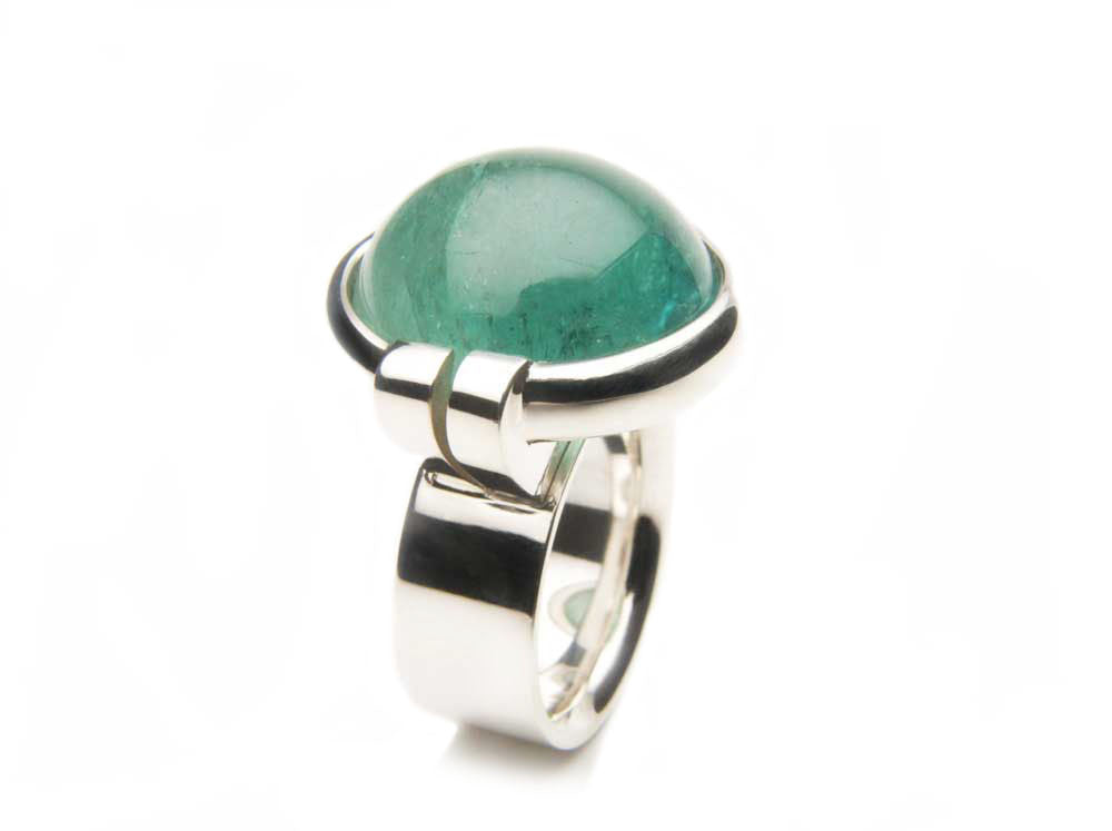 Sterling silver and a 24.0 carat blue-green Tourmaline cabochon. Price upon request. $0.00