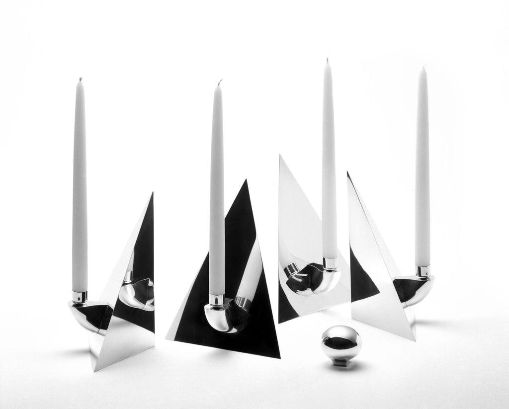 Solid sterling silver. A mirror-bright four-sided pyramid breaks apart into 4 free standing three-sided pyramids, each with its own candleholder. Height 10