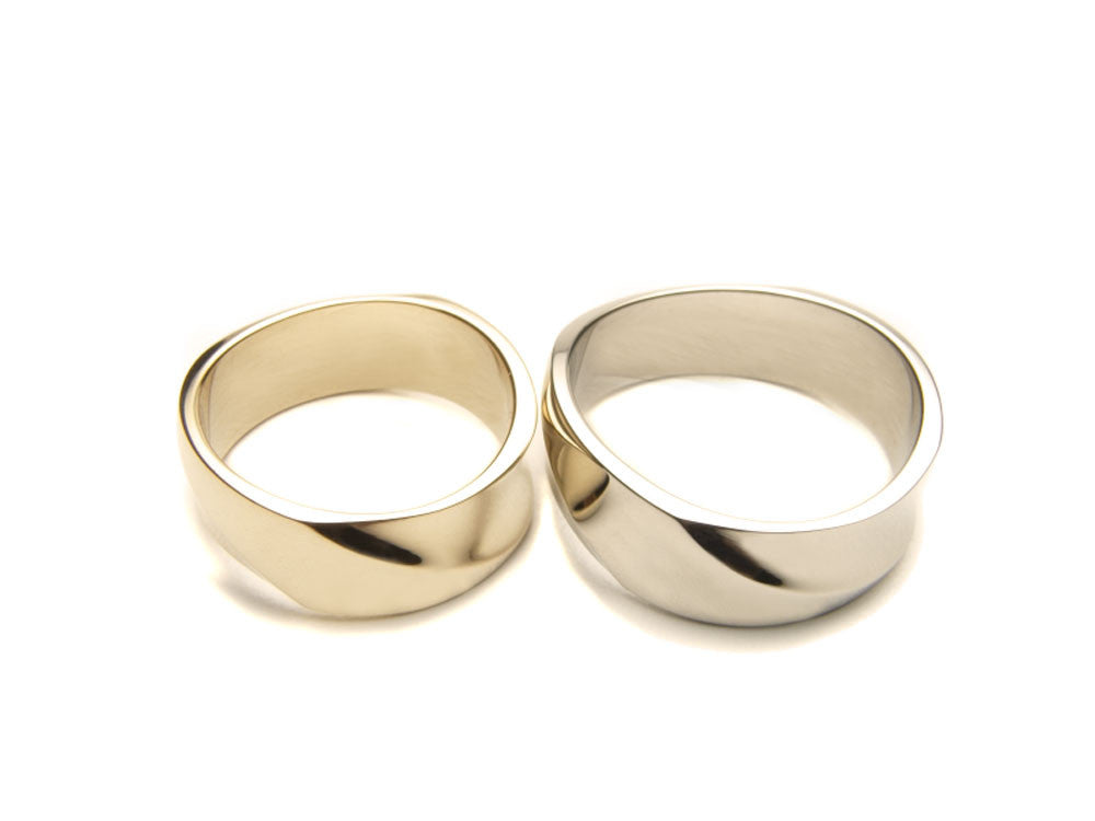 Eighteen karat gold wedding bands. Width 6.90 mm.  $1,280.00