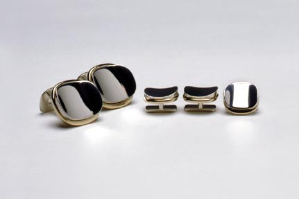 Cuff-links in sterling silver and eighteen karat gold. Shown with matching Tuxedo studs TS003. $780.00