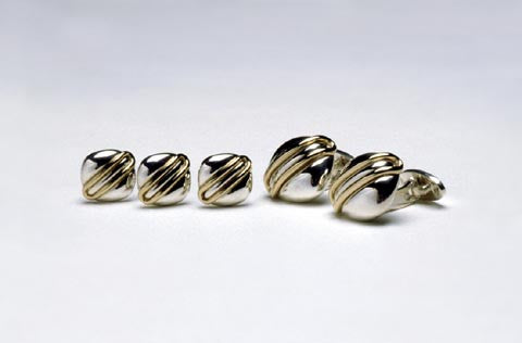 Cuff links in sterling silver and eighteen karat gold. Shown with Tuxedo studs TS012. $780.00