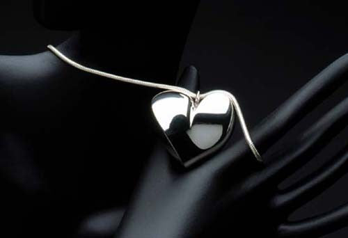 Sterling silver heart pendant on a sterling silver chain. $1,350.00
