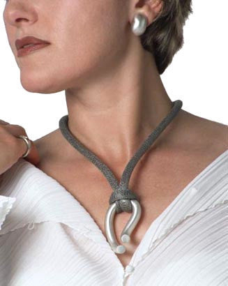 Sterling silver pendant on steel mesh or silk cord, tubular puzzle clasp. $980.00