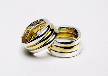 Waved three rings in one band, sterling silver and eighteen karat gold.  $940.00