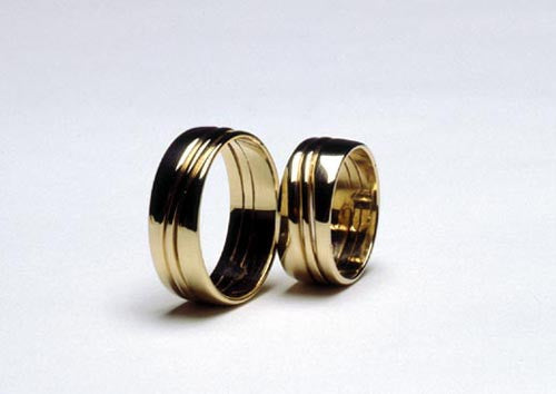 Eighteen karat gold wedding bands.  $1,400.00