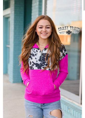 Hot pink cow print pullover