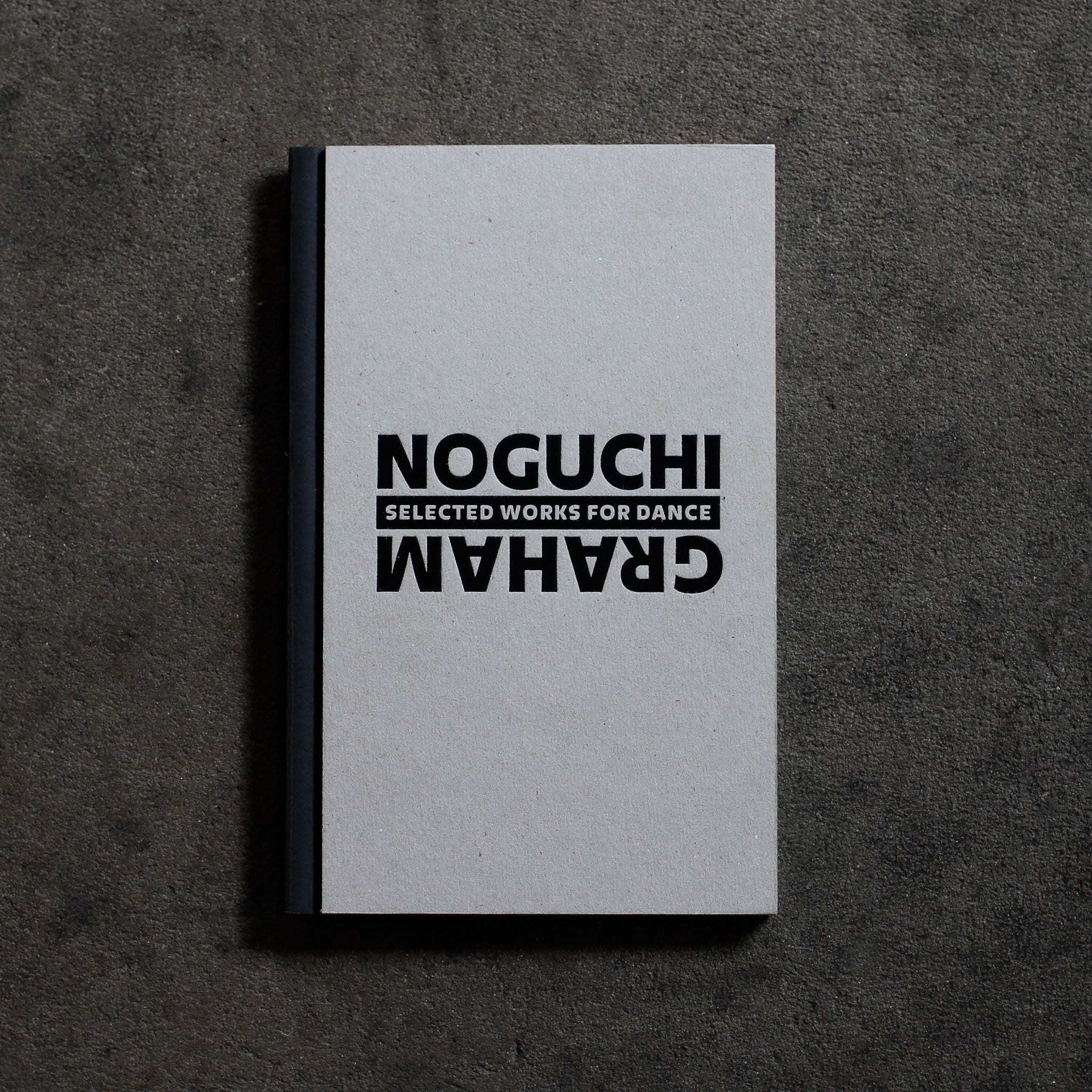 Cover of 'Noguchi / Graham: Selected Works for Dance.' Chipboard cover with foil stamped black type and black cloth spine.