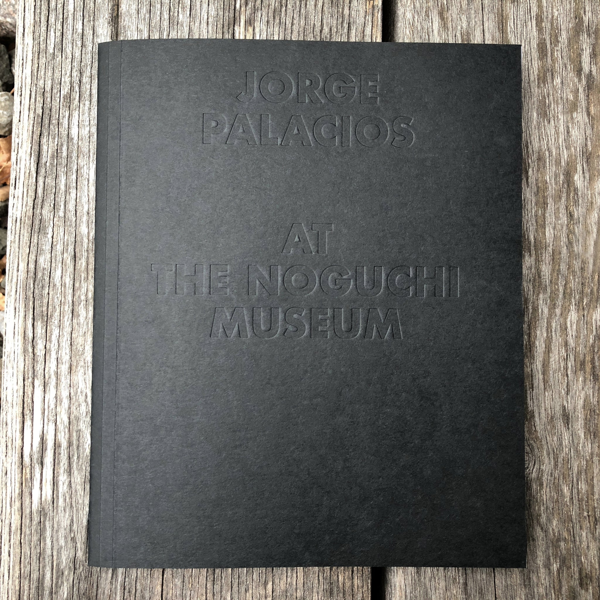 'Jorge Palacios at The Noguchi Museum' cover. Black paper cover with blind-stamped sans serif type.