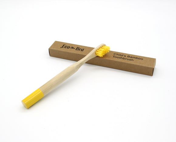Yellow children's bamboo toothbrush with recyclable cardboard box