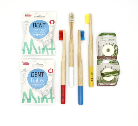 Four plastic free bamboo toothbrushes 2 packets of denttabs toothpaste tablets and organic dental floss twp pack