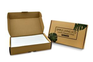 Simple Living Eco laundry detergent sheets. Open cardboard box with white sheets laundry