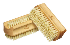 Two wooden nail brushes with plant based bristles