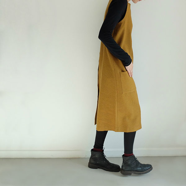 Simple in form, this easy-to-wear dress is cut perfectly from fine wool, with minimal shapes. It is also available in both charcoal and navy, along with this mustard linen alternative.