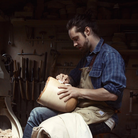 Alex devol hand carving a large wooden bowl