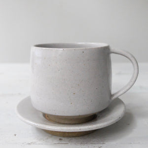 Pottery West Tea Cup and Saucer