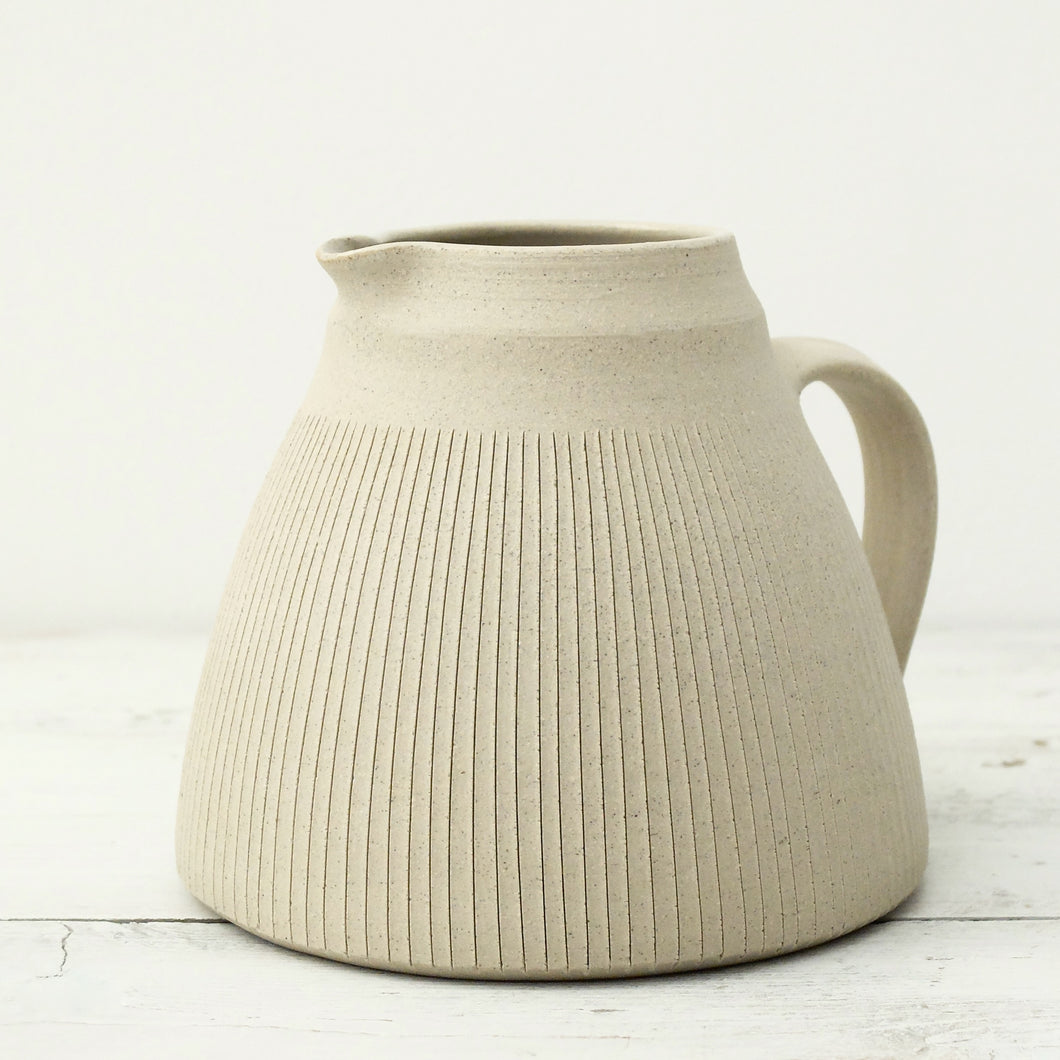 Nicola Tassie polished stoneware fat jug with incised lines