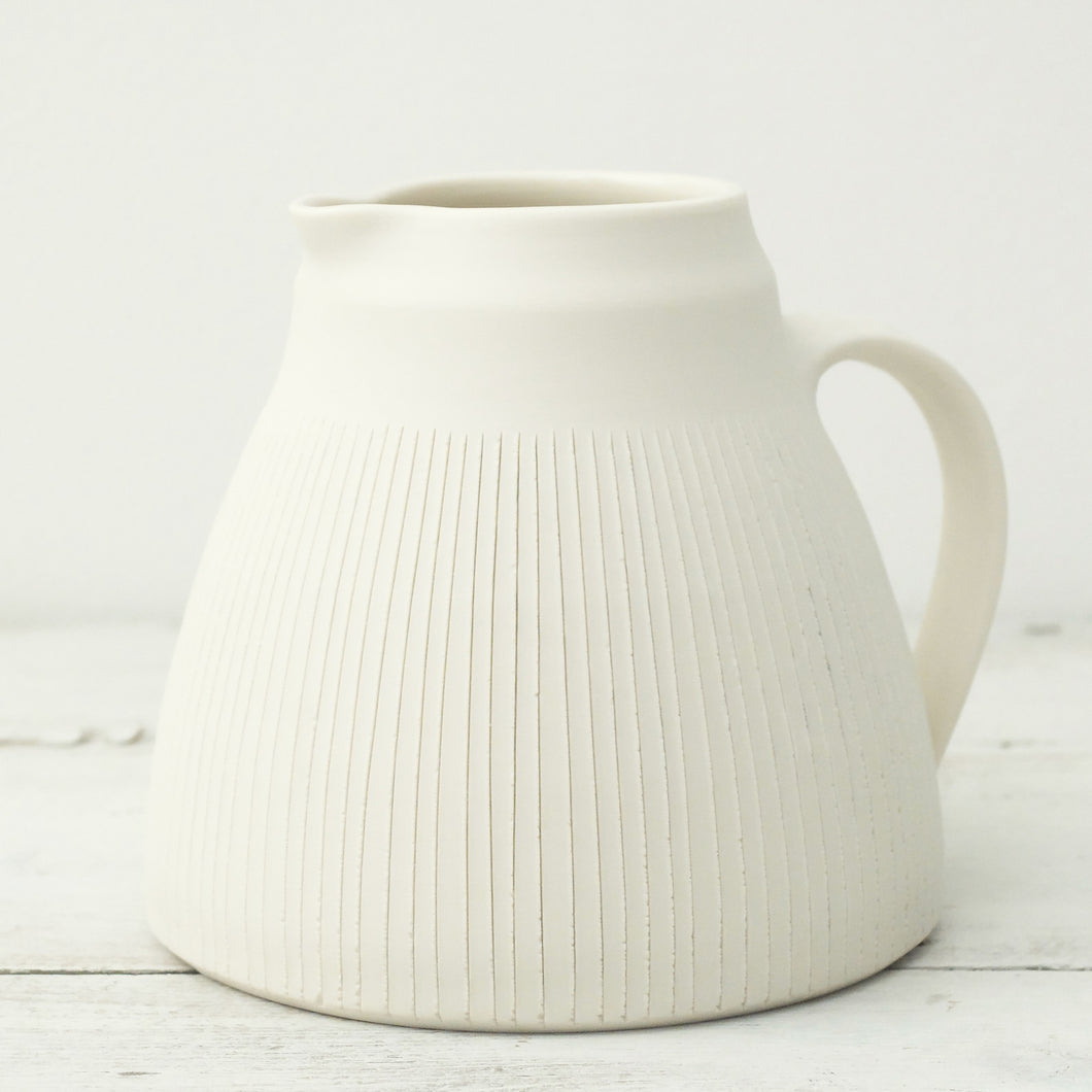 Nicola Tassie Polished porcelain jugs with incised lines