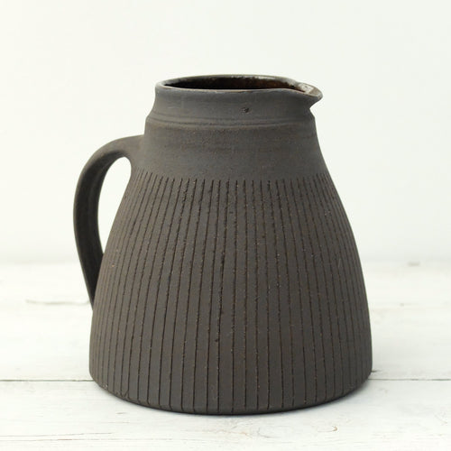 Nicola Tassie black stoneware jug with incised lines