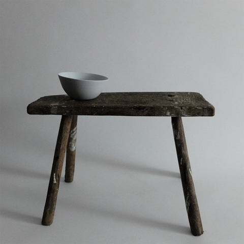 Porcelain bowl on wooden stool