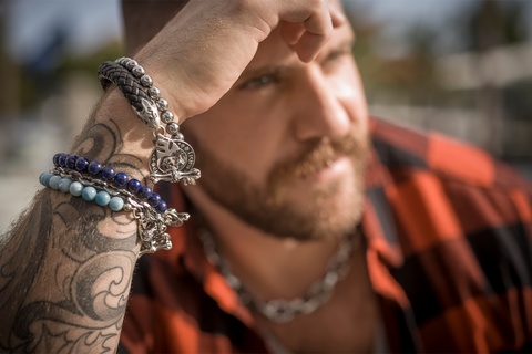 man wearing tribal son jewelry bracelets in red plaid shirt