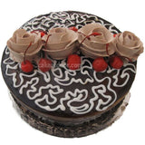 Light chocolate cake with 4 flowers and cherries - C012