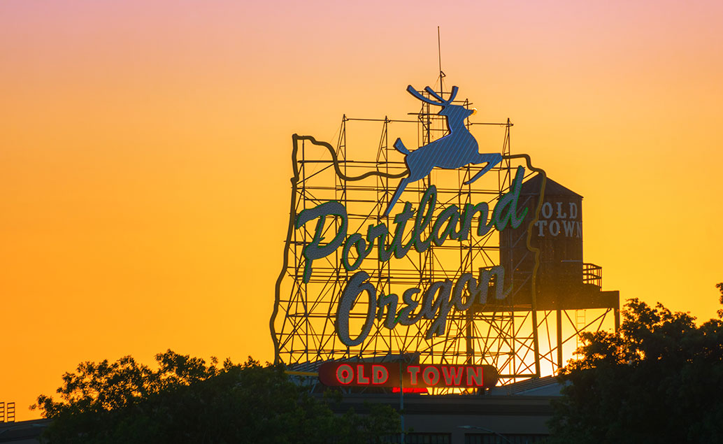 portland oregon old town sign at sunset
