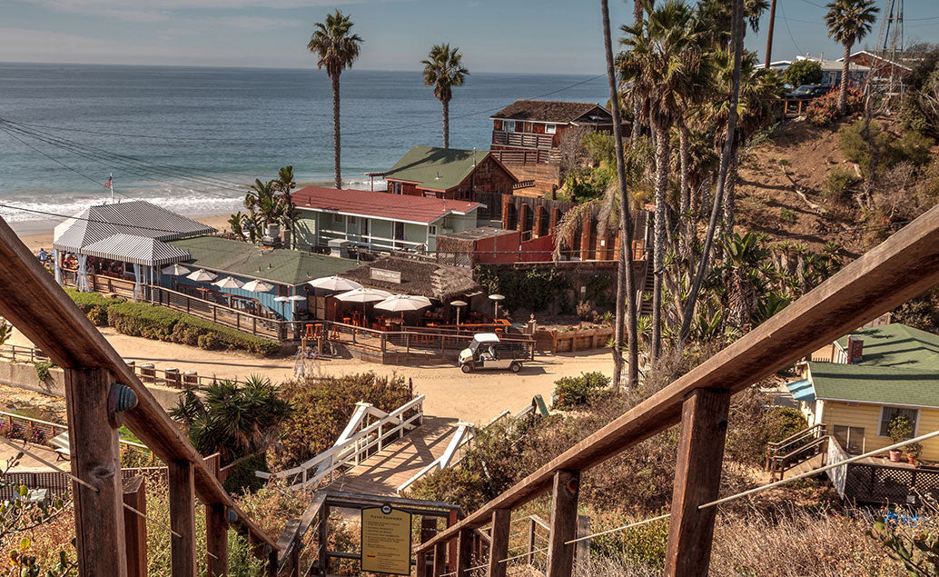 top of stairs view to beach buildings
