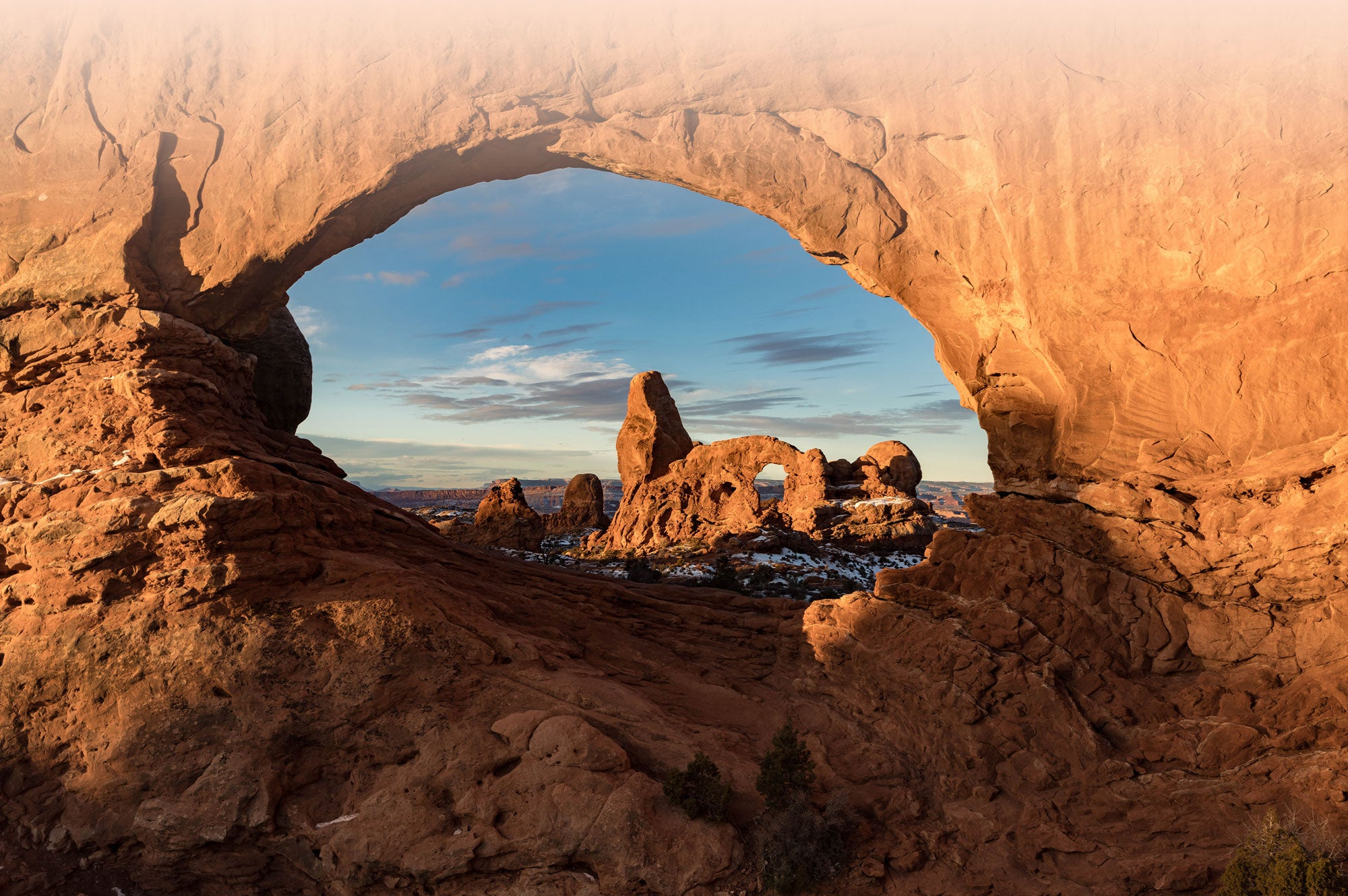 Looking through rock arch to another