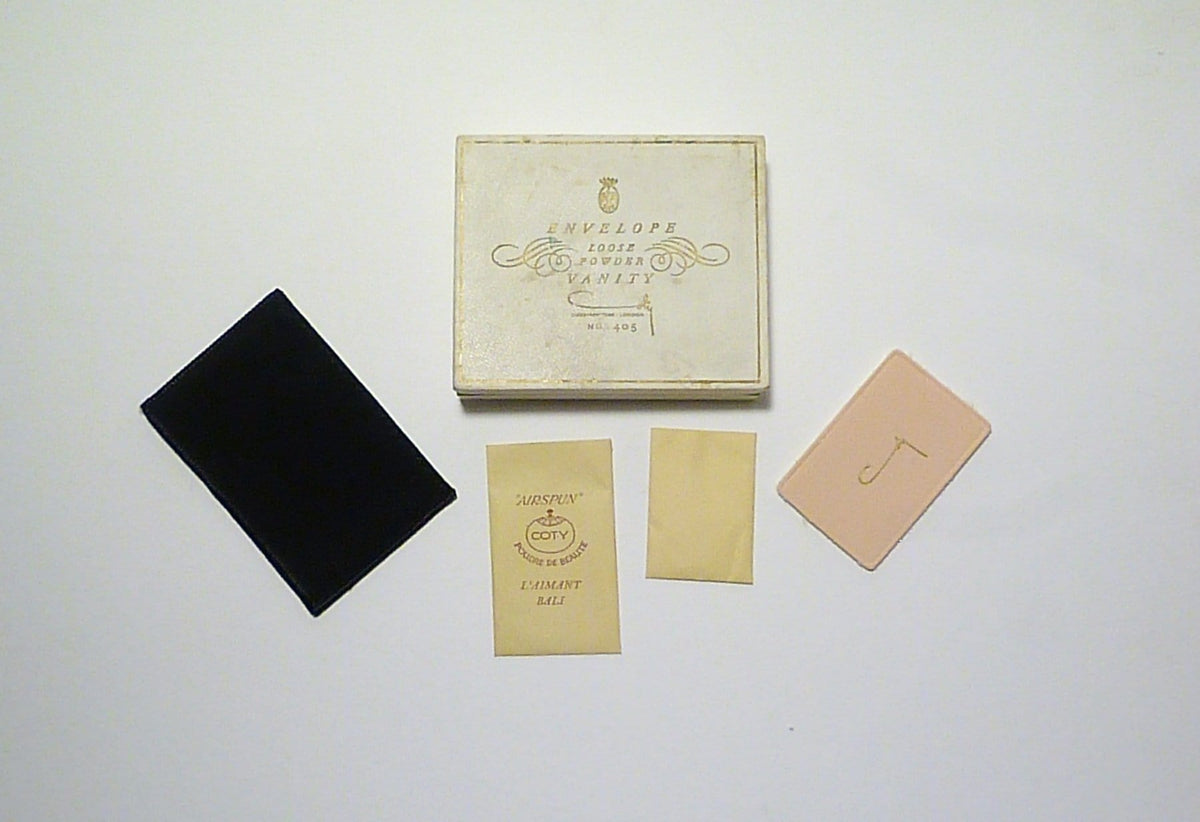 boxed unused Coty Envelope compact