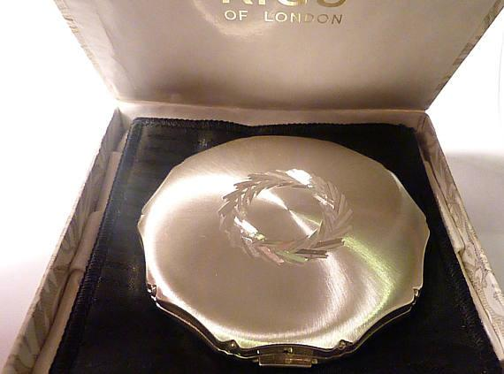 25th anniversary gifts for her unused sterling silver Kigu powder compact 1973