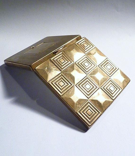Art Deco powder compacts