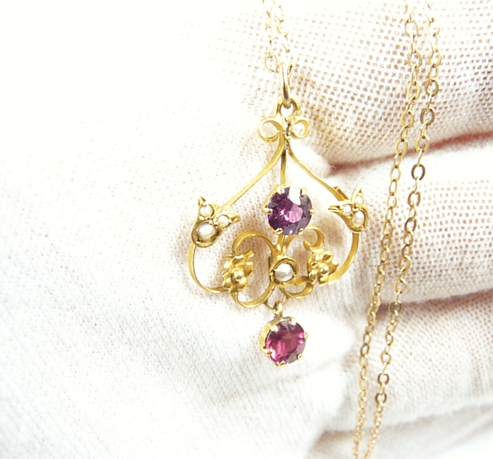 Hallmarked Gold Garnet And Seed Pearl Pendant.
