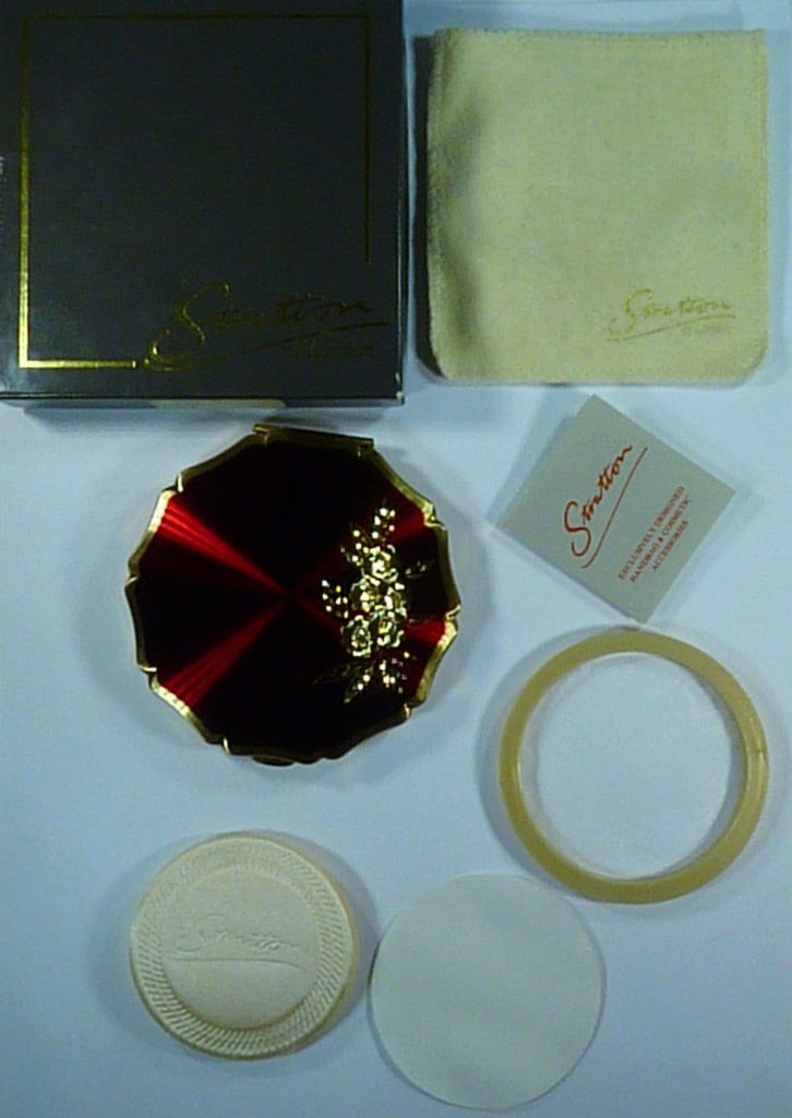 Unused stratton  powder compact with the original box