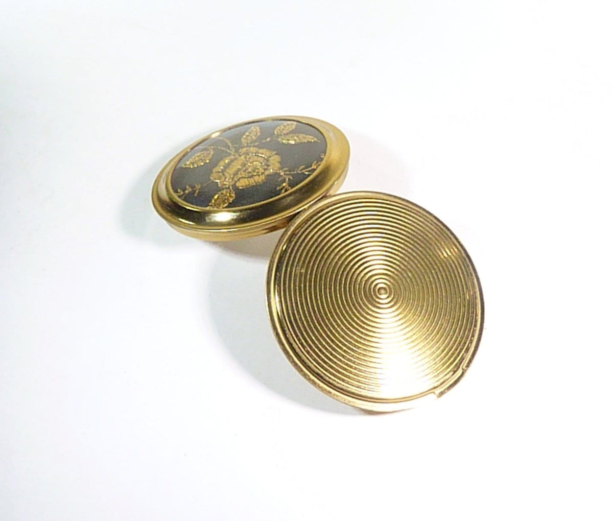 black and gold rose vintage compact