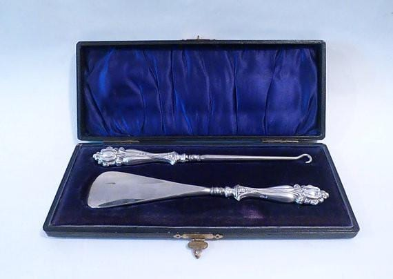 Edwardian silver shoe horn and button hook repoussage