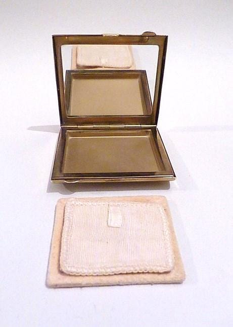 loose powder compact