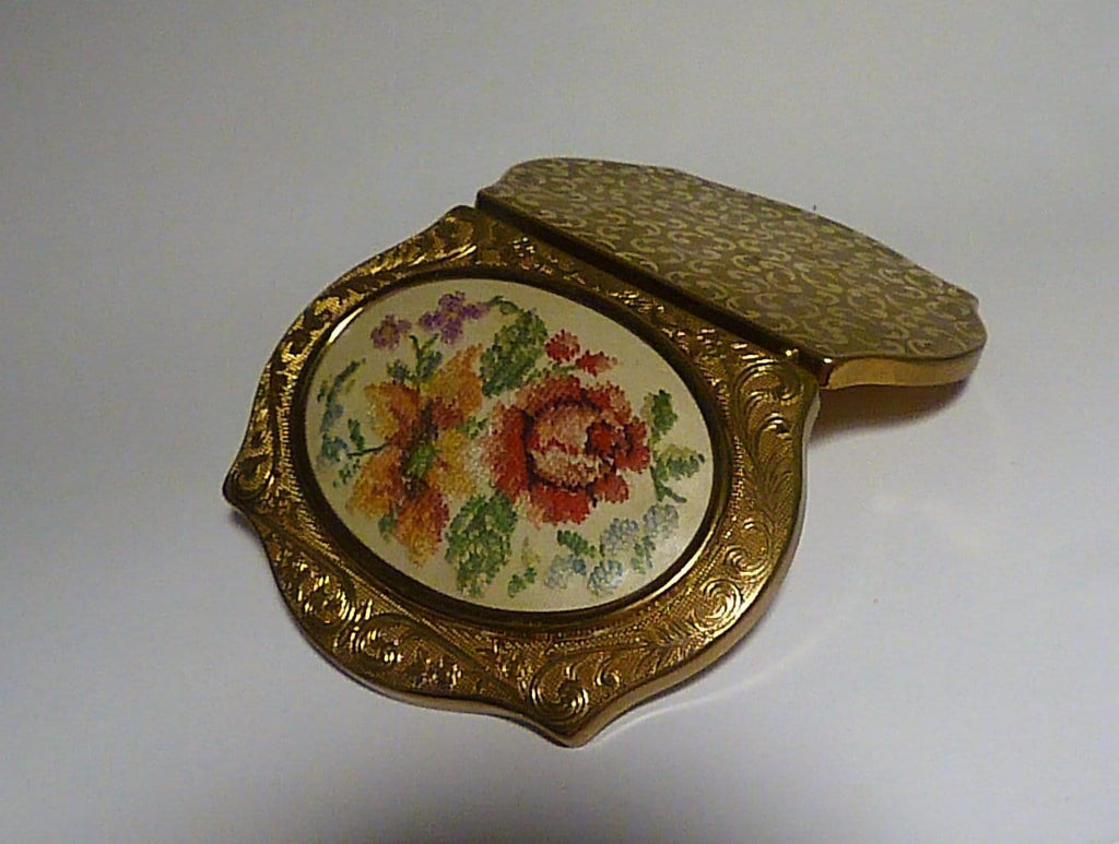 needle point powder compacts
