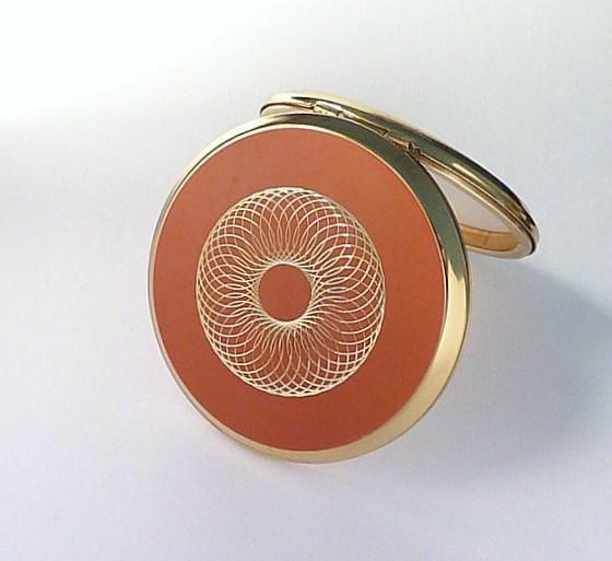 orange and gold stratton powder compact