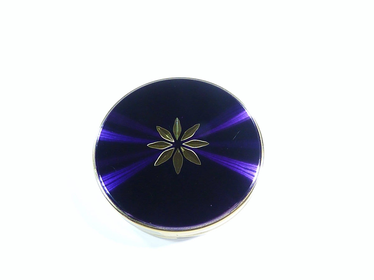 purple and gold refillable compact for compressed face powder Max Factor Creme Puff