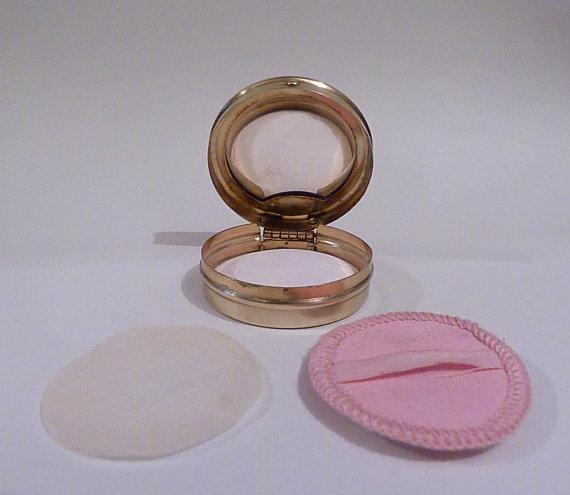 rare powder compacts