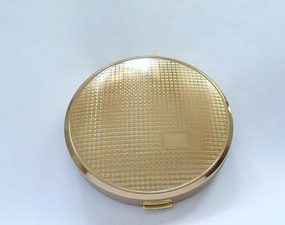 unused vintage powder compacts