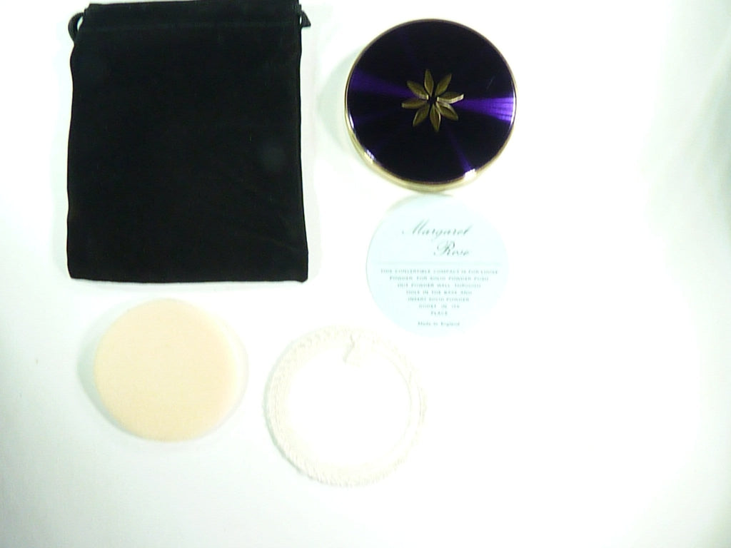 vintage compact with pouch and puff
