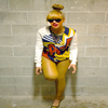 She has us thinking:  Beyonce Bun & Bangs