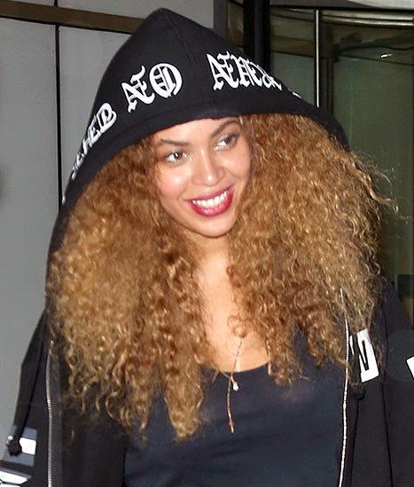 Beyonce with blonde kinky curly indian hair extensions
