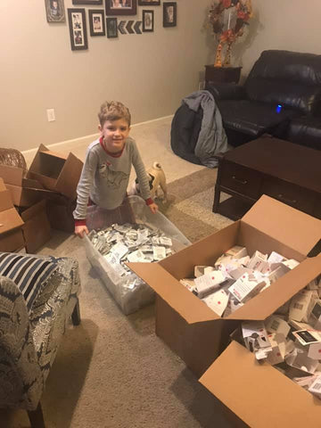 #ShipHappens Founder, Antonia Sawyer's son, Basil Sawyer helping package Narcan kits for distribution.