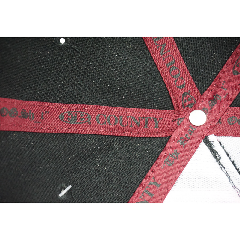 Inside Lining of the FB County 3D Cap/Hat. Red Straps with Black FB County Text and metal button.