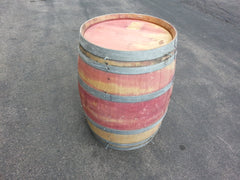 Beautiful red wine barrels feature solid oak and steel construction with unique coloring.
