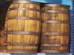 Authentic whiskey barrels from a local distillery are perfect decor for your western or country themed event.