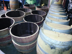 Large order of barrel halves, cut and ready for pallets.  We can handle your large order, too!